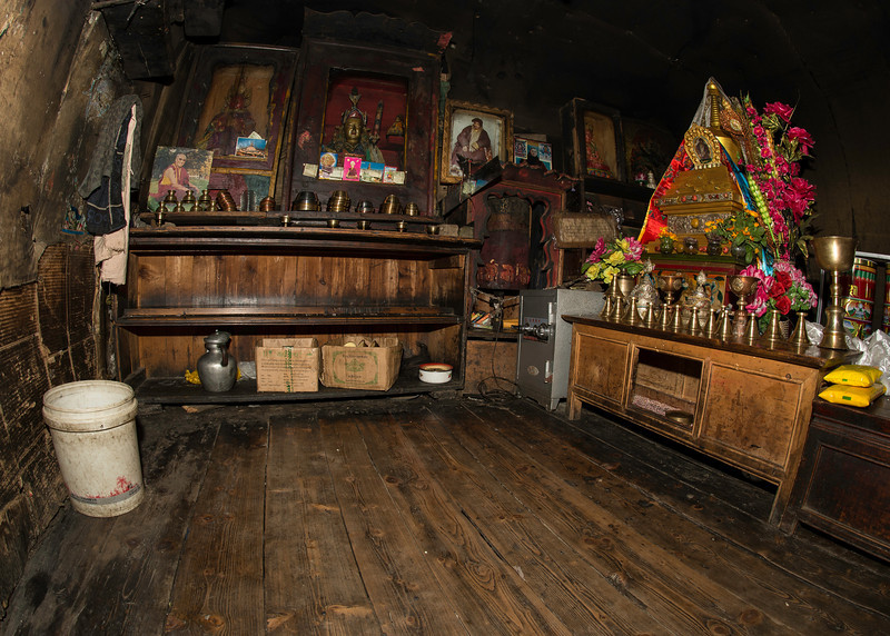 This is the cave where the head Lama of Ani (nunnery) Tashi Gompa, Ake Tsephel Rinpoche went into solitary retreat at age 25.  Rinpoche passed away around 2005 after sixty years in retreat.  The cave has been preserved as a shrine in his honor.