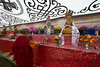 Nun attends to the alter at Ani (nunnery) Tashi Gompa