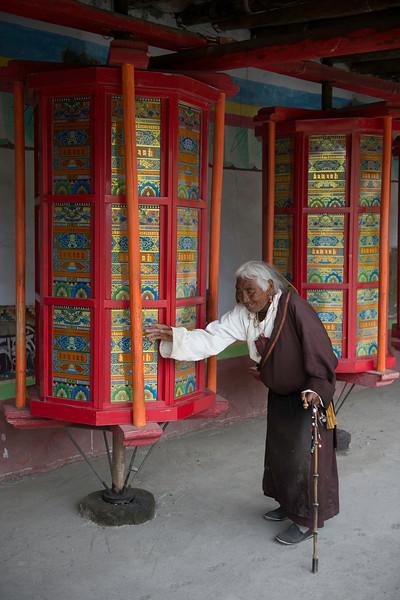 Tibetan woman circumambulating Lhagong Monastery in Tagong