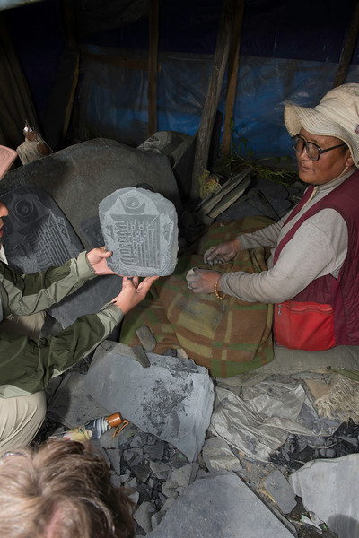 A stone carver will carve mantras into stones called mani stones at Ani (nunnery) Tashi Gompa