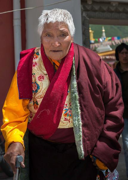 Tibetan nun going to see the cham or Tibetan Ritual dancing in Tagong