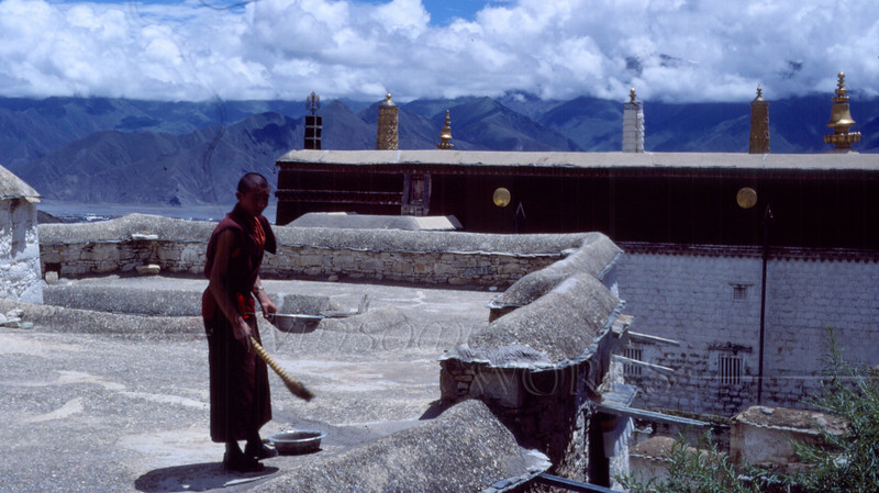 Monk on rooftop at Drepung Monastery; Lhasa, Tibet