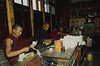 Monks putting repairing or putting scrolls together in a monastery (Possibly Tasilhunpo or Sakya?)