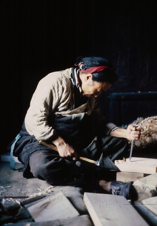 Woodcarver seen on our overland trip through Tibet