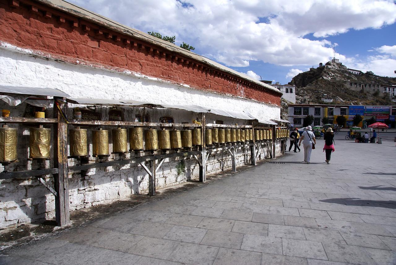 Prayer wheels on palace grounds.