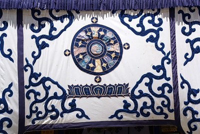 Center banner over Utse main entrance. The circle in the center is the Dharma wheel.
