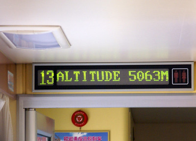 Altitude sign in passenger car.