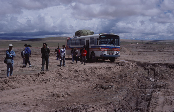 Our bus heading over the plateau towards Lhasa... A bridge was out, so we all had to walk while the bus navigated through some frightening-looking terrain. We met up across the way! This was the first time I felt the effects of altitude sickness.