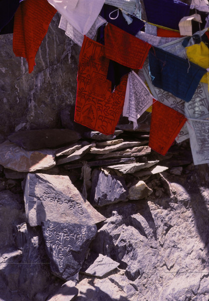 Prayer flags and stone carvings behind the Potala