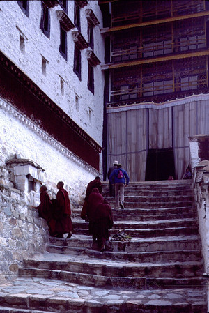 Monks on steps of the Potala Palace