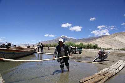 Pushing the loaded ferry away from the Samye landing.