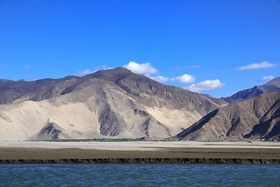 Sand piles on mountains along Yarlung river, near Samye.