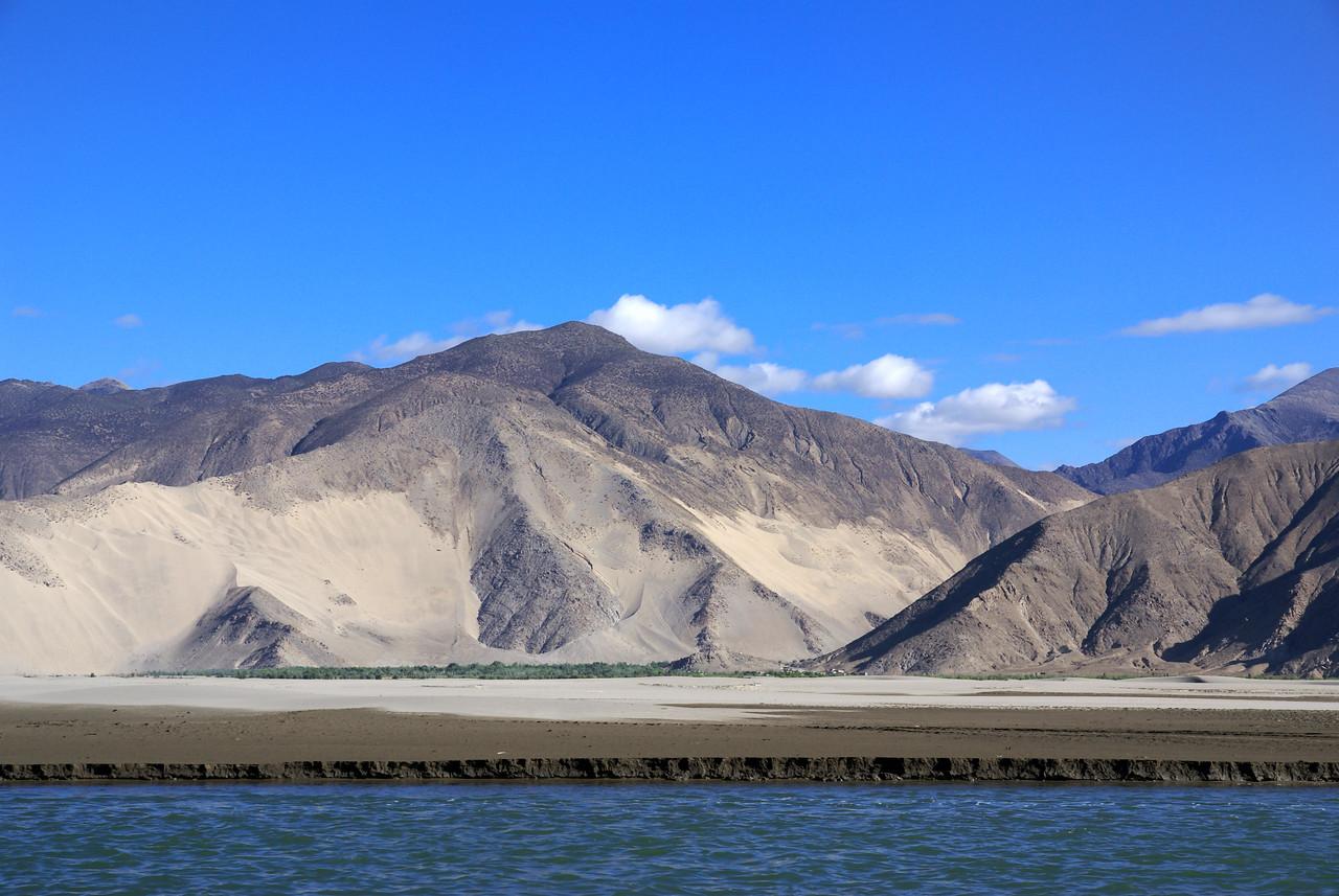Sand piles on mountains along Yarlung river, near Samye.