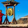 Ngor Monastery near Shigatse - Monk signaling the call to Prayer