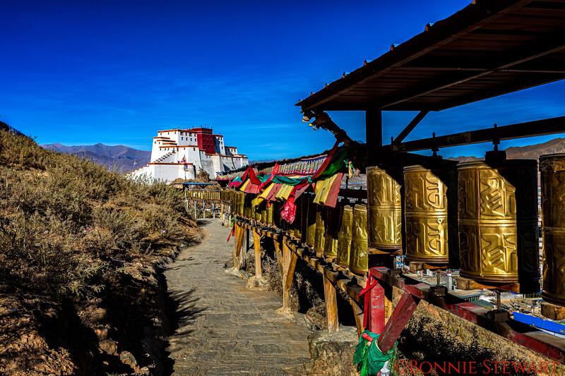 Walking towards the Zong Castle along the Prayer Wheels Path