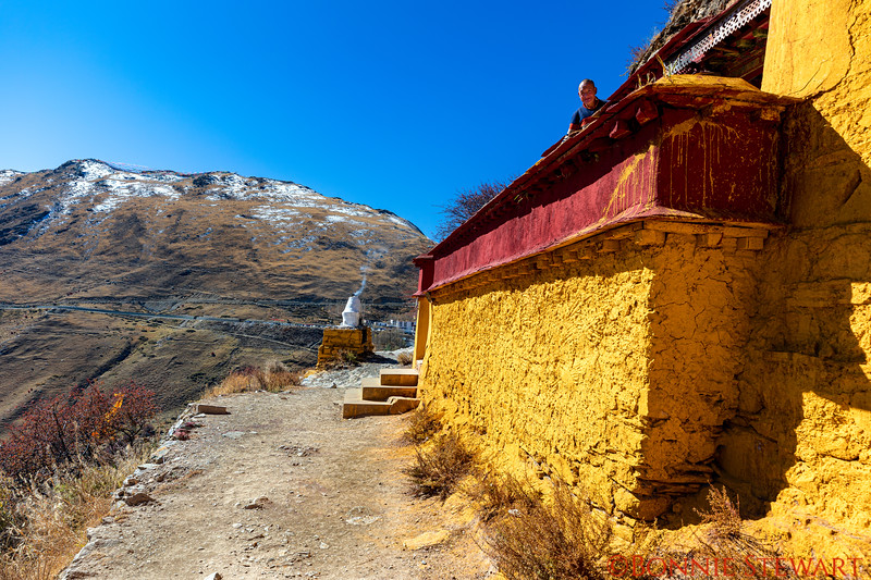 Ganden Monastery house where founder stays.  He is looking over the Ledge.