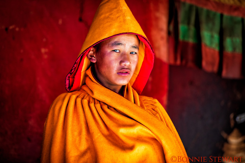 Monk waiting for the  prayer call wearing the shawl.