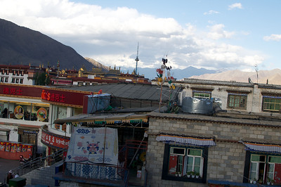 Guards with guns on the rooftops in Lhasa. 2010.