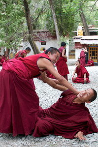 Debating Monks at the Sera Monastery in Lhasa Tibet. Getting a little rowdy.