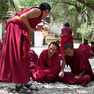 Debating Monks at the Sera Monastery in Lhasa Tibet. These two seem to be pondering the question posed to them pretty seriously.