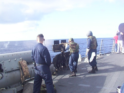 Firing the 50 caliber at a 55 gal drum thrown overboard.