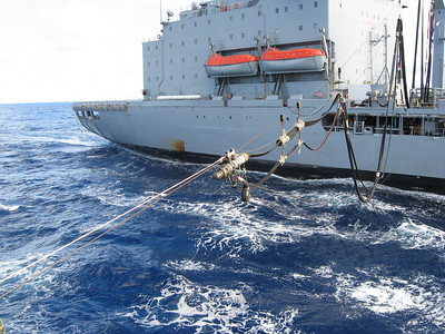 Supply ship sending over the fuel line.