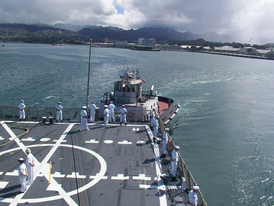 Tug pushing us out of Pearl Harbor.