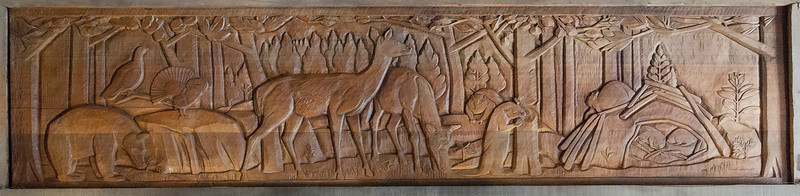 Forest scene carved by Erich Lamade.