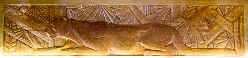 lintle woodcarving of a mountain lion.