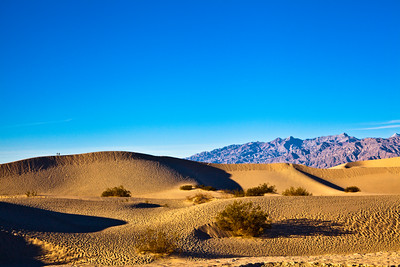 Visitors on the sand dunes in Death Valley