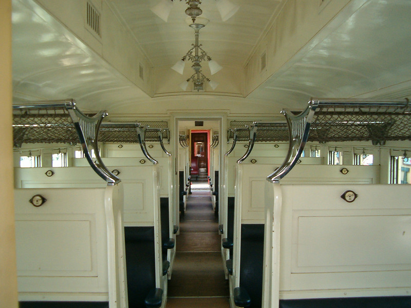 Inside one of the passenger cars. Note the luggage racks. Travelling in style on the long overnight journeys. This is a Series 50 carriage.