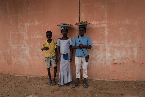 Posing for a photo - Ouida, Benin
