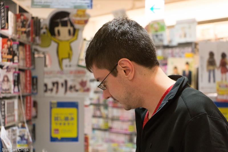 Alan browsing the manga section of a book store near Shibuya crossing.