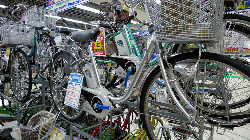 "Bicycle store - it seems that ""power assisted pedaling"" is getting popular in Japan.  Check out the battery."