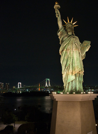 Rainbow Bridge and Statue of Liberty, Tokyo, Japan as seen from Daiba
