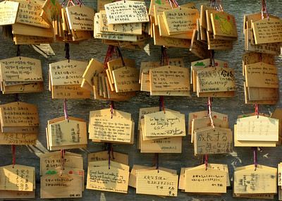 I wasn't able to find out what these wooden cards are but I deduced each has a proverb.