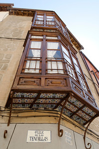 beautiful balconies adorned with hard wood and decorative tiles on the underside. I wonder what they see on the inside.