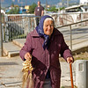 An interesting old Greek lady, selling her creations