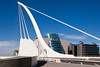 The Samuel Beckett Bridge is the newest bridge to cross the River Liffey in Dublin, Ireland. The modern structure is curved in the shape of a harp and uses cables, like a suspension bridge, to maintain the structure.