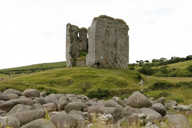 Castle Minard is an old castle on the west coast of Ireland near the Dingle peninsula, destroyed by an explosion several hundred years ago. The stones on the nearby beach provide foreground interest.