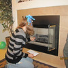 We asked Torrie to help clean the fireplace before the treasure hunt could continue!