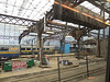 Union station work on roof of train shed.