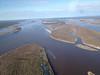 Aerial looking up river showing Moose Factory and Moosonee.