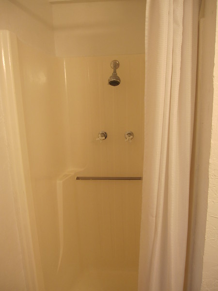 CRI - Room #10's shower.  A fiberglass insert design.  No mold on shower curtain.