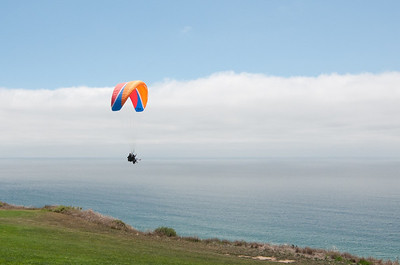 While a group of us played the South Course's 4th hole, one of our colleagues (with an instructor) came paragliding along side us.
