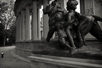 MADRID - Parque Del Retiro - One of those grab shots. It struck me at the time that the statues in the foreground were calling to or watching over the small child. I must have a fanciful mind.
