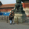 Beijing, China - Peter and Beverly in front of one of numerous stone lions inside Forbidden City