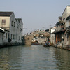 Suzhou - a water village scene featuring an arch bridge