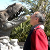 Kunming (昆明) - Museum and active dinosaur excavation site, named Dinosaur Valley, near Kunming.  Peter yelling back at a man-made dinosaur replica.
