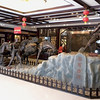 Kunming (昆明) - Carvings inside a shopping center showing men and horses laden with burdens of tea traversing the Ancient Tea Horse Route (茶馬古道), transporting from Yunnan to Tibet and SE Asia.